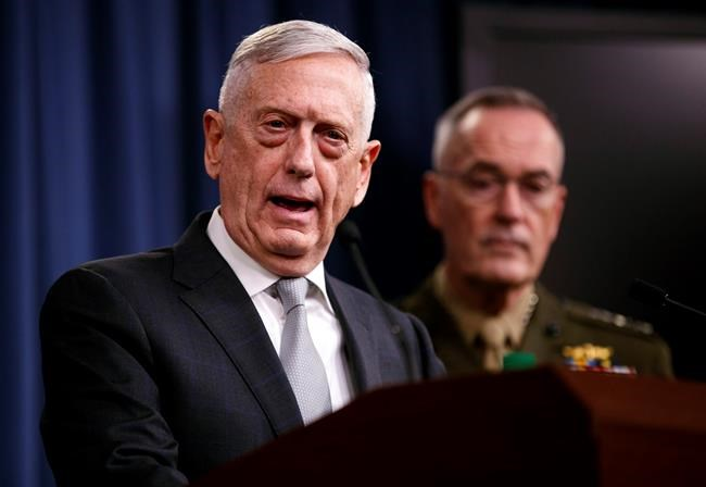 Defense Secretary Jim Mattis, joined by Joint Chiefs Chairman Gen. Joseph Dunford, speaks at the Pentagon, Friday, April 13, 2018, on the U.S. military response, along with France and Britain, in response to Syria's chemical weapon attack on April 7.'Äã (AP Photo/Carolyn Kaster)