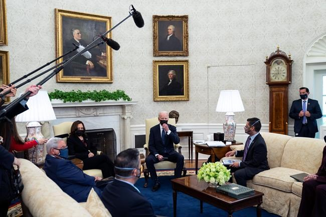President Joe Biden and Vice President Kamala Harris meet with members of the Congressional Hispanic Caucus, in the Oval Office of the White House, Tuesday, April 20, 2021, in Washington. (AP Photo/Evan Vucci)