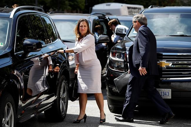 Canada's Foreign Affairs Minister Chrystia Freeland, left, walks to a car during a break in trade talk negotiations from the Office of the United States Trade Representative, Thursday, Aug. 30, 2018, in Washington. At right is David MacNaughton, Canada's Ambassador to the United States. (AP Photo/Jacquelyn Martin)