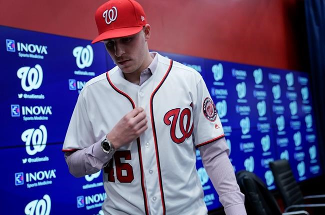 Washington Nationals new pitcher Patrick Corbin stands up during a baseball news conference at Nationals Park in Washington, Friday, Dec. 7, 2018. Corbin agreed to terms on a six-year contract and joins the Nationals after playing for the Arizona Diamondbacks. (AP Photo/Pablo Martinez Monsivais)