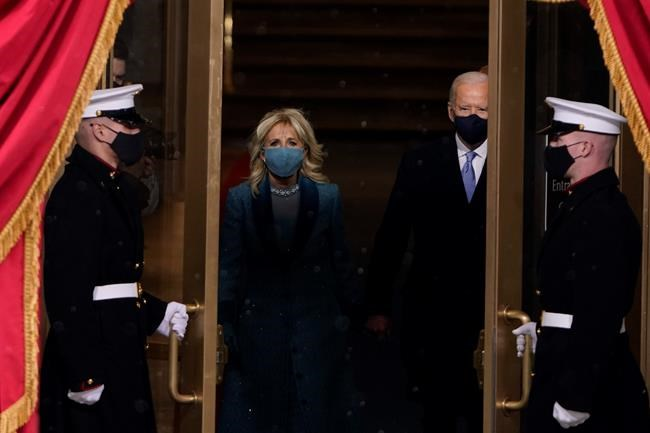 President-elect Joe Biden and his wife Jill, walk out for the 59th Presidential Inauguration at the U.S. Capitol in Washington, Wednesday, Jan. 20, 2021.(AP Photo/Patrick Semansky, Pool)