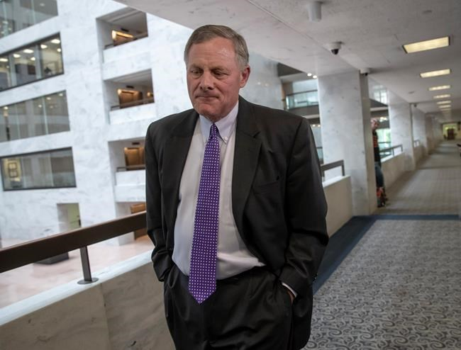 Senate Intelligence Committee Chairman Richard Burr, R-N.C., goes behind closed doors as members of the Senate Intelligence Committee arrive to vote on Gina Haspel, President Donald Trump's pick to lead the Central Intelligence Agency, and to meet with former national security chiefs on Russian meddling in the 2016 campaign, on Capitol Hill in Washington, Wednesday, May 16, 2018. (AP Photo/J. Scott Applewhite)
