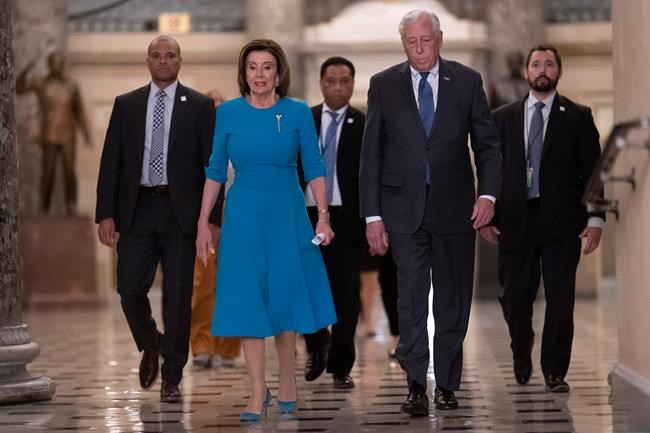 Speaker of the House Nancy Pelosi, D-Calif., and Majority Leader Steny Hoyer, D-Md., arrive to make a statement ahead of a planned late-night vote on the coronavirus aid package deal, at the Capitol in Washington, Friday, March 13, 2020. (AP Photo/J. Scott Applewhite)