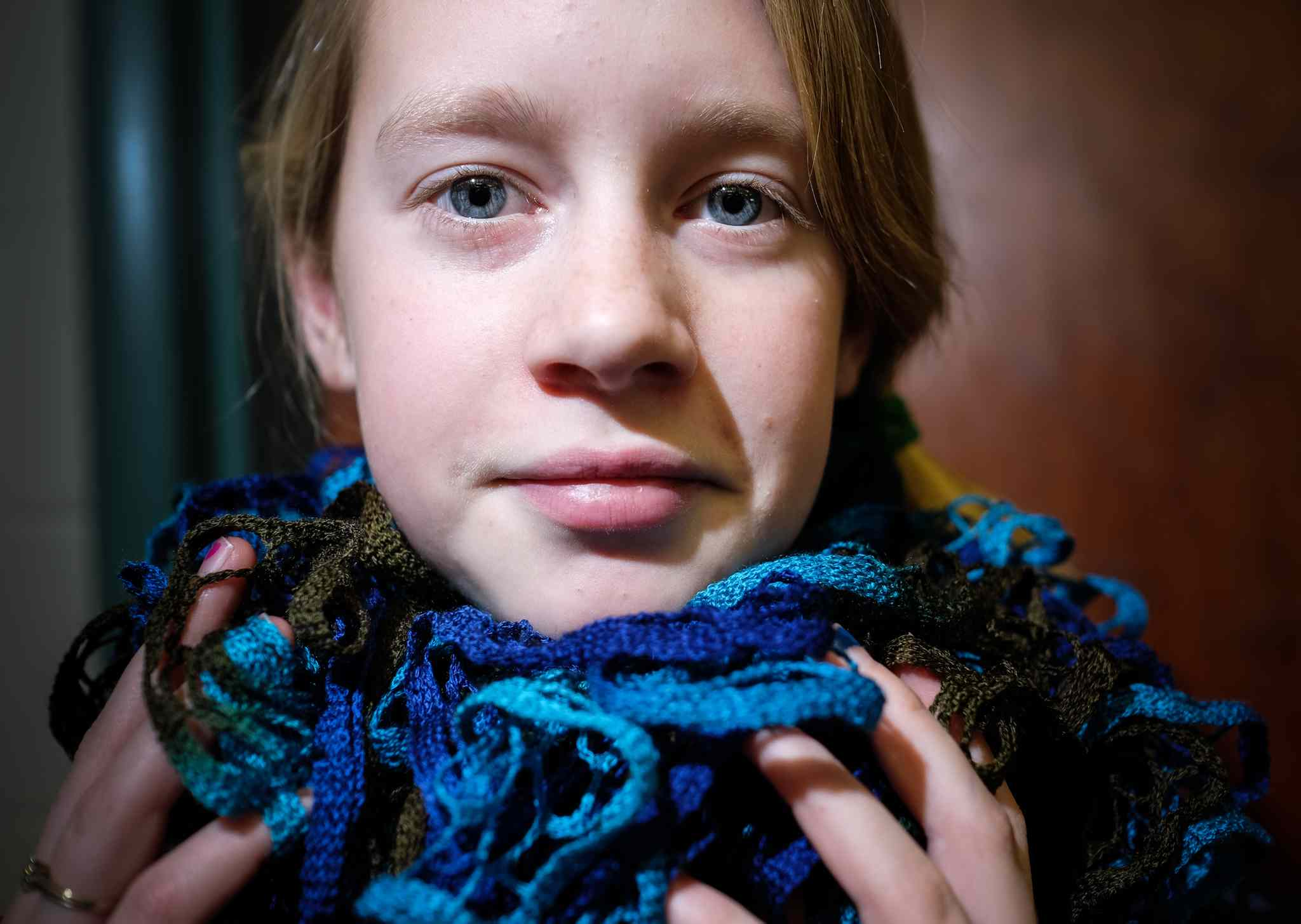 Avrey Murdy, 11, shows off a fancy scarf she knitted in Elaine Owen's class at Miami School, southwest of Winnipeg. The class has donated clothing to shelters and made items for gifts and donations.