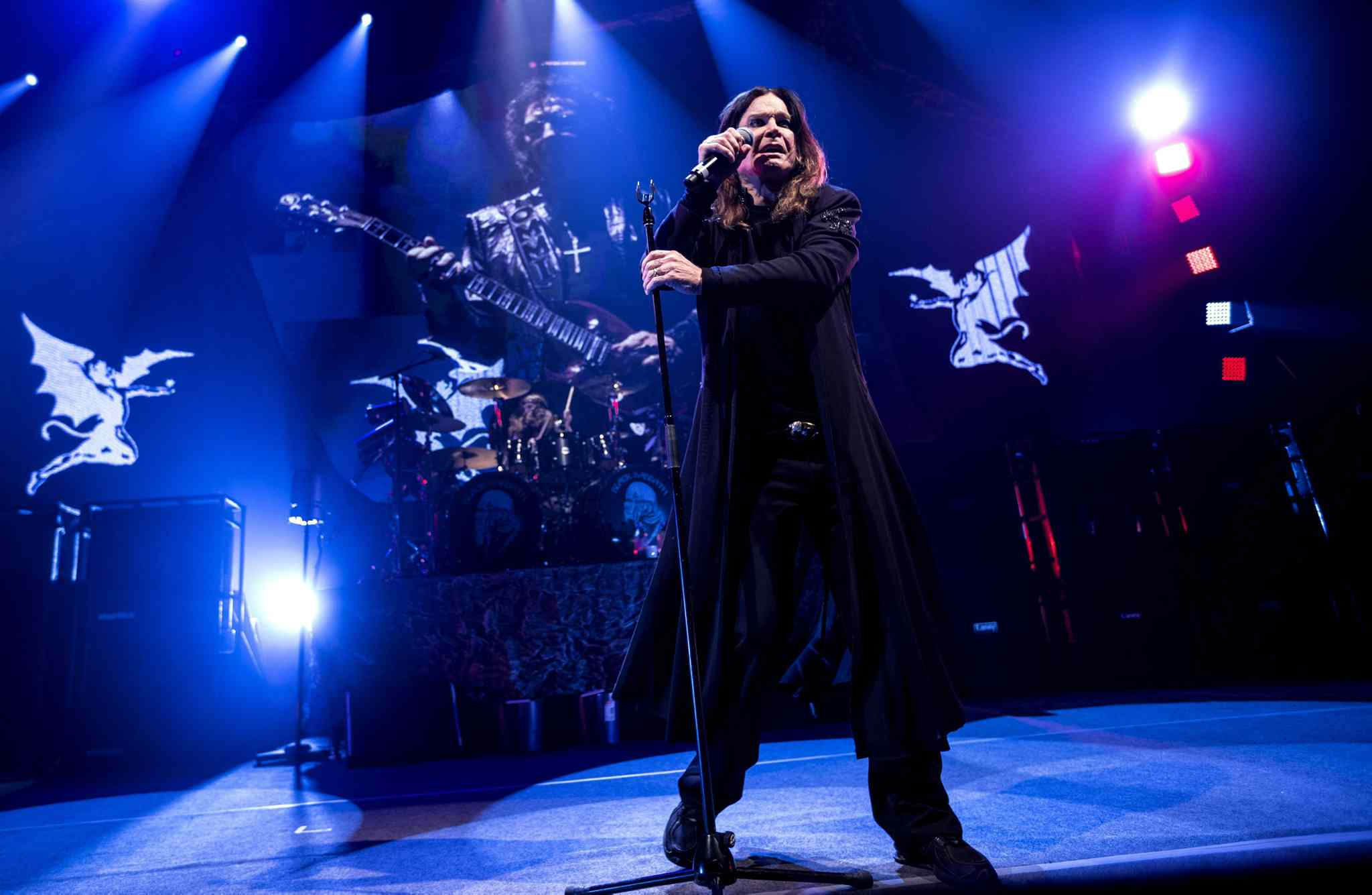 Black Sabbath singer Ozzy Osbourne performs with guitarist Tony Iommi, seen on screen behind, during a concert earlier in the tour in Denmark. Winnipeg fans at Wednesday's show got to see that while Osbourne may have mellowed in his age, he's a commanding presence who still gives all he's got.