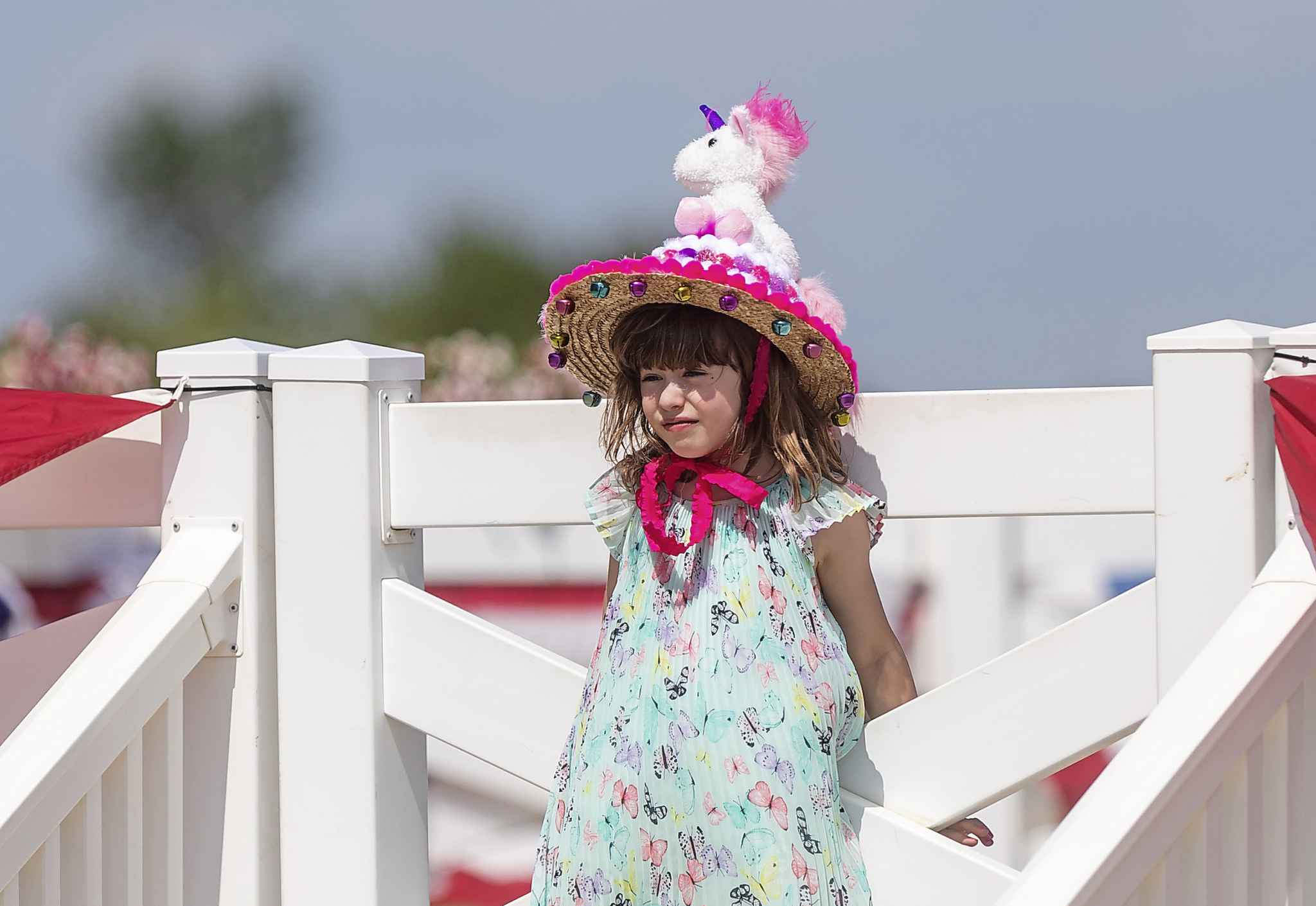 Maeve Millard-Hales shows off her fancy unicorn hat at the Manitoba Derby Monday afternoon at Assiniboia Downs.