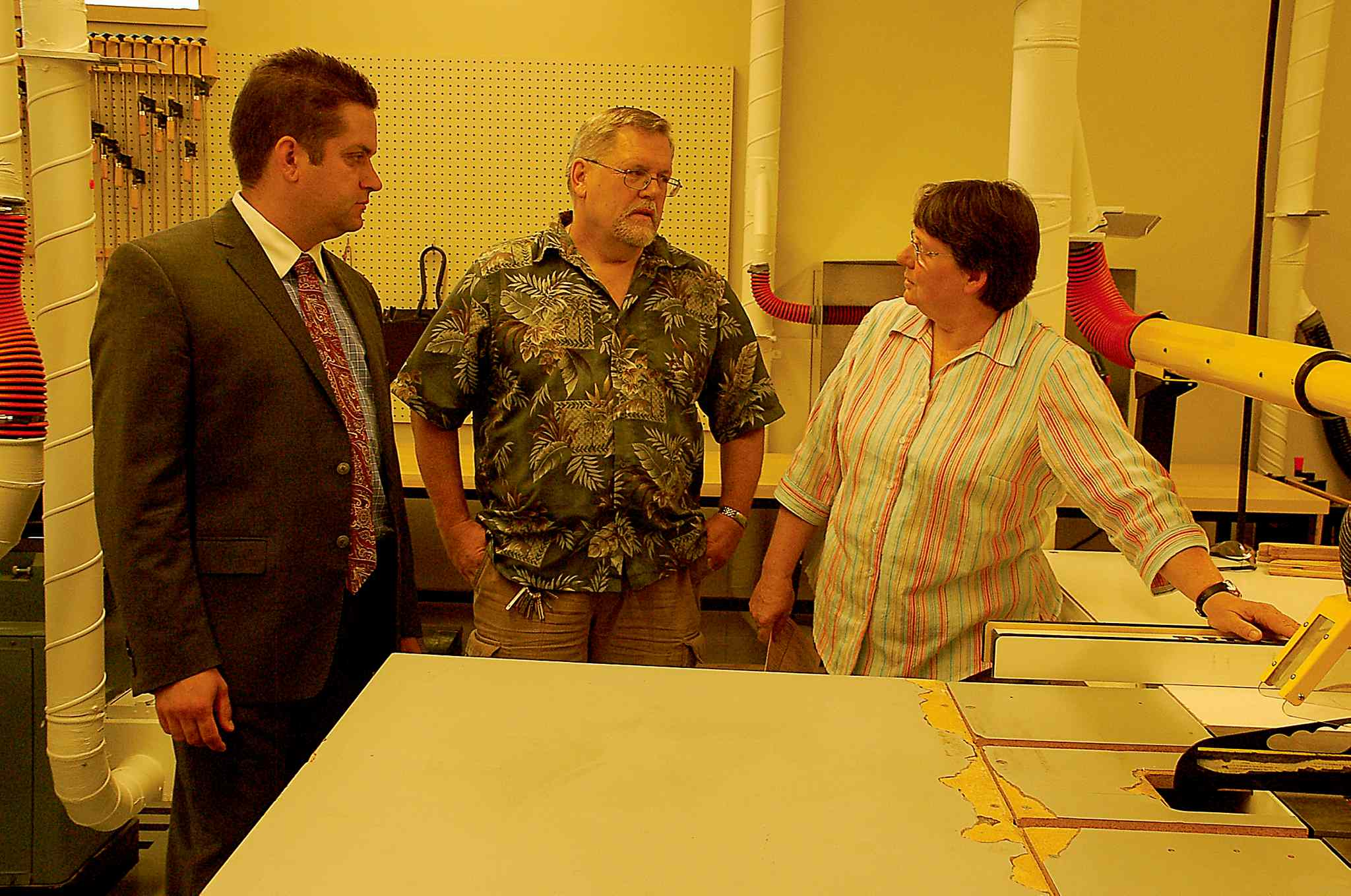 Coun. Jeff Browaty (North Kildonan), Bronx Park Community Club president Jos Gatien, and wood shop co-ordinator Michaelene Ness are shown at the unveiling of the club's wood shop on Aug. 20.