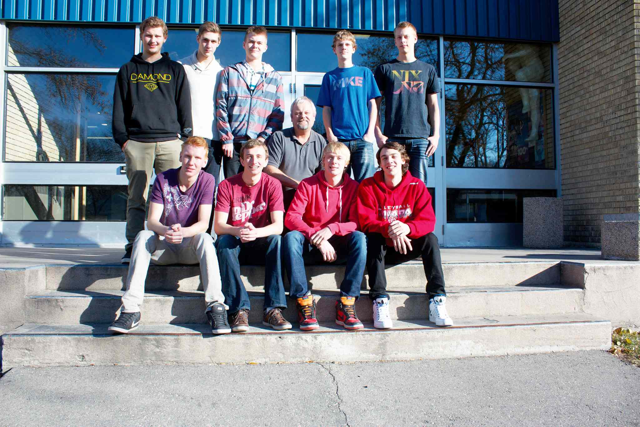 The Calvin Christian Eagles boys' volleyball team is shown.  Front row: Spencer Janzen, Colin Kamerman, Lyle Koop, and Dalon Hordyk.  Back row: Trevor Dalmaijer, Matthew Ginter, Ted Jeninga (head coach), Riley Bouwman, Kyle Reenders, and Jordan Davis.