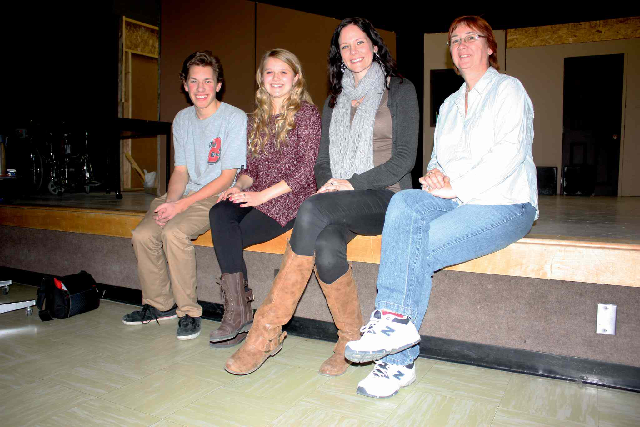 Radium Girls leads Harlan Billson and Sydney Small, director Carrie Gillis, and assistant director Shelley Lichtman are shown. Miles Macdonell Collegiate will stage the play in December.