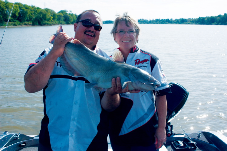 WindRiver Professional Guide Services founders Frank and Dorothy Normand are shown with a catfish caught on the Red River near Selkirk on Aug. 31.