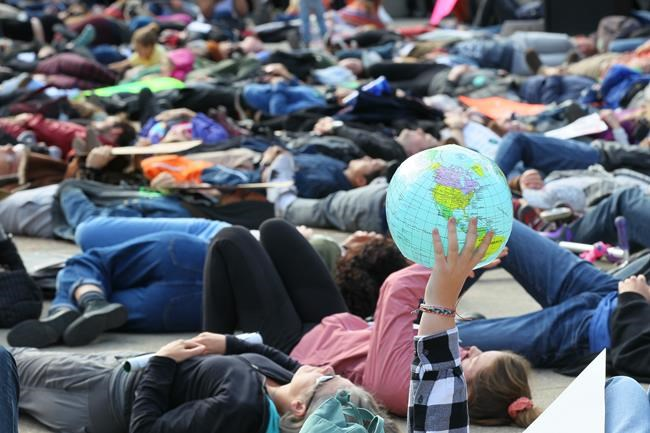 "Climate change activists and students gather for a protest and ""die-in"" on the steps of the Calgary Municipal Building in Calgary on Friday, Sept. 20, 2019. THE CANADIAN PRESS/Dave Chidley"