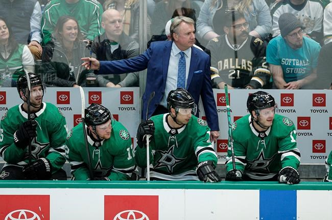 Dallas Stars interim head coach Rick Bowness looks on from the bench during the first period of an NHL hockey game against the Vegas Golden Knights Friday, Dec. 13, 2019, in Dallas. (AP Photo/Brandon Wade)