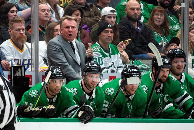 "Dallas Stars interim head coach Rick Bowness yells to his players in the first period of an NHL hockey game against the New Jersey Devils, Tuesday, Dec. 10, 2019, in Dallas. Bowness was announced as interim head coach earlier in the day after former head coach Jim Montgomery was fired for ""unprofessional conduct."" (AP Photo/Jeffrey McWhorter)"