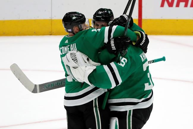 Dallas Stars' Blake Comeau, left, Mattias Janmark (13) and goaltender Anton Khudobin, right, celebrate after a shoot-out against the Chicago Blackhawks in an NHL hockey game in Dallas, Saturday, Nov. 23, 2019. The Stars won 2-1. (AP Photo/Tony Gutierrez)