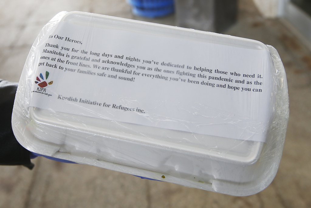 The message on the boxes of food dropped off for staff Grace Hospital Monday. The gesture is part of the project called From Our Kitchens To Our Heros where community organizations, Chinese, and Asian restaurants are uniting to provide 50 meals each night to 50 front-line health workers fighting COVID-19.