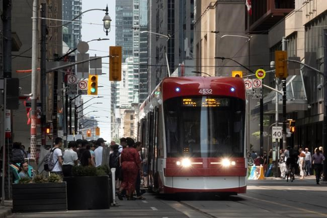 Transit riders board a streetcar in downtown Toronto on Wednesday, July 10, 2019. Ridership on two of Ontario's largest transit agencies is down between 80 and 90 per cent since the start of the COVID-19 pandemic, in a situation a national industry group said mirrors the experience of many local services. THE CANADIAN PRESS/Graeme Roy