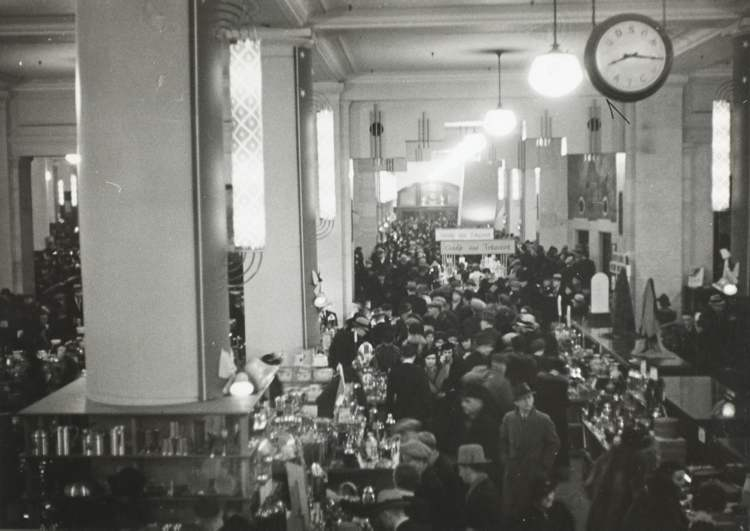 The Bay's main floor is elbow to elbow with Christmas shoppers in this 1940s photo. - Hudson