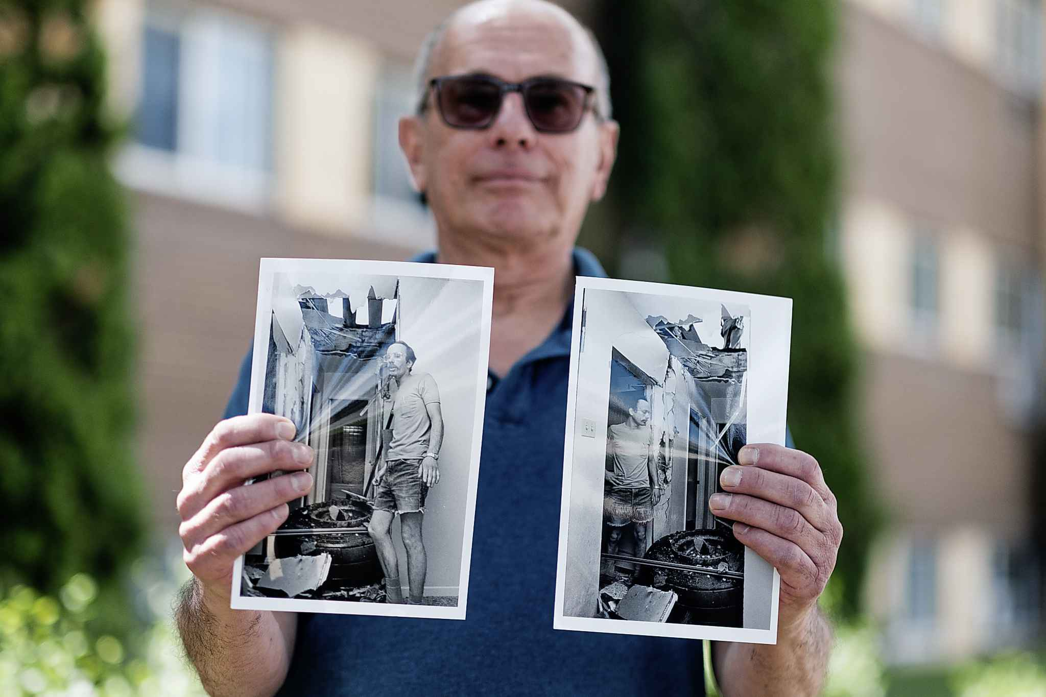 Mark Paul stands outside the Grant Avenue apartment, where he lived in July 1982, when a 400 pound wheel from an airplane came crashing through the roof narrowly missing him.