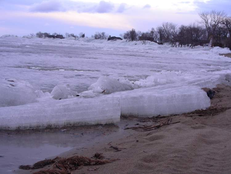 Massive wedges of ice are seen along the Ochre Beach on Dauphin Lake.