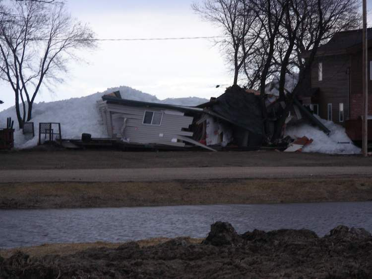 A building is destroyed by the Dauphin Lake ice floe.