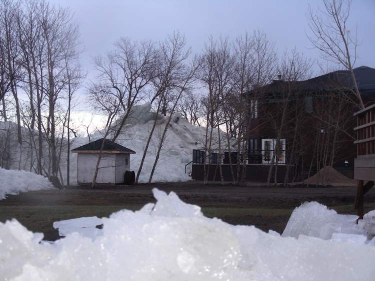Hills of ice surround a property in the Dauphin Lake region.