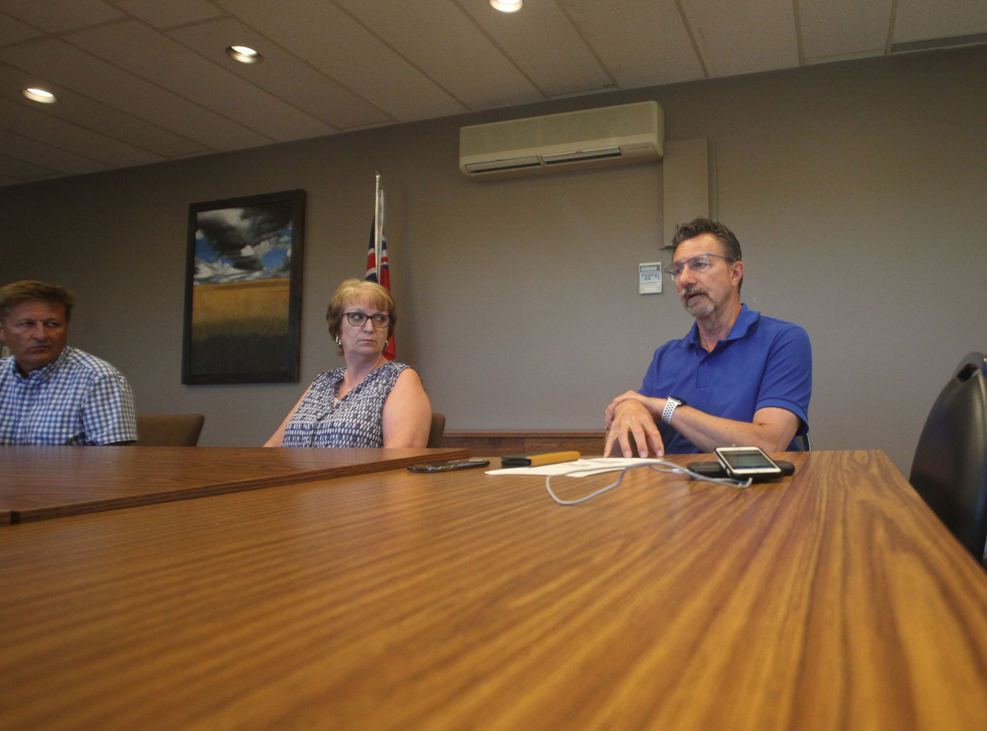 Mayor Rick Chrest speaks as Agassiz MLA Eileen Clarke and Infrastructure Minister Ron Schuler look on during a media conference in Brandon on Wednesday evening.
