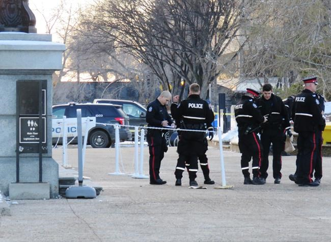 "Police stand outside of the Alberta Legislature after being called to the building mid-afternoon for a weapons complaint related to a body that was found on the front steps of building on Monday, December 2, 2019. Edmonton police say they were called to the building mid-afternoon and that what happened was ""non-criminal."" THE CANADIAN PRESS/ Dean Bennett"