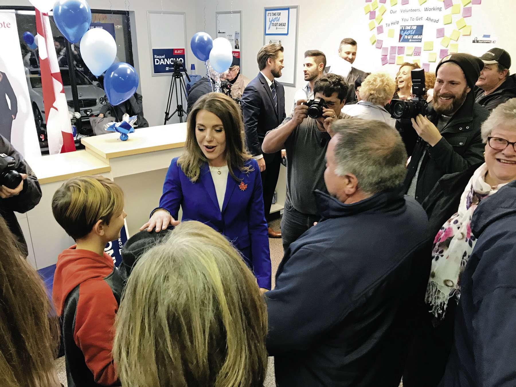 Kildonan-St. Paul MP-elect Raquel Dancho, a Conservative, accepts congratulations from some young supporters at her campaign headquarters on election night.