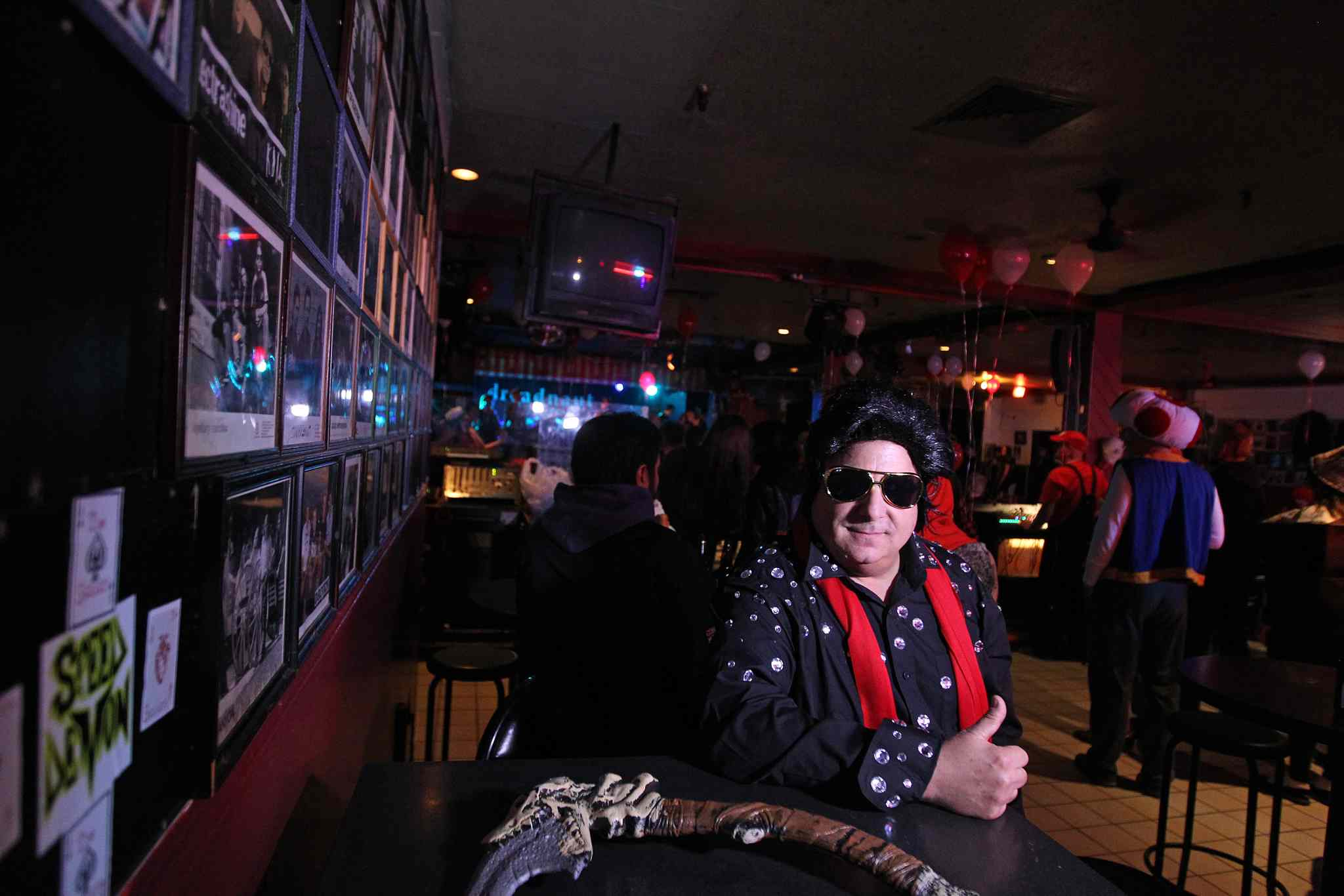 Dave Green wears an Elvis costume for Halloween on The Zoo's last night of operation.