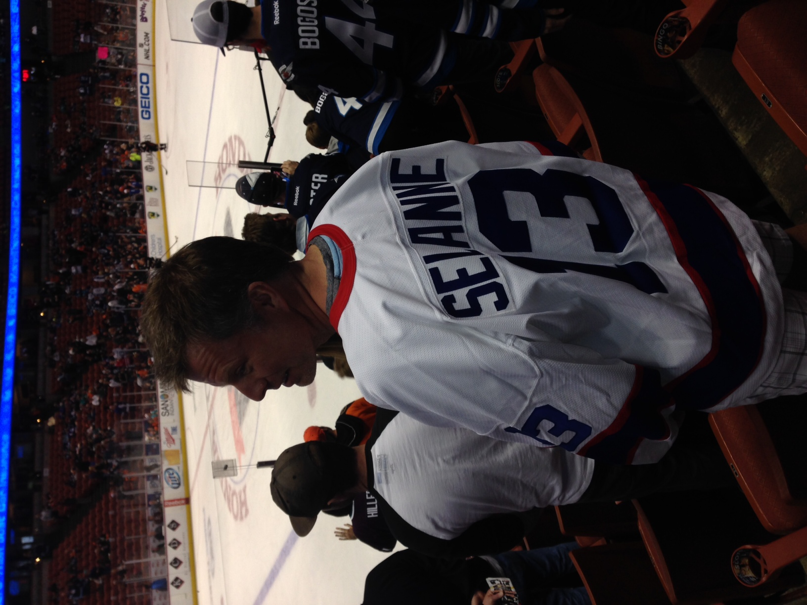 Jets' fan David Vanderwees, in his vintage Selanne jersey, watches the team warm up in Anaheim Monday.