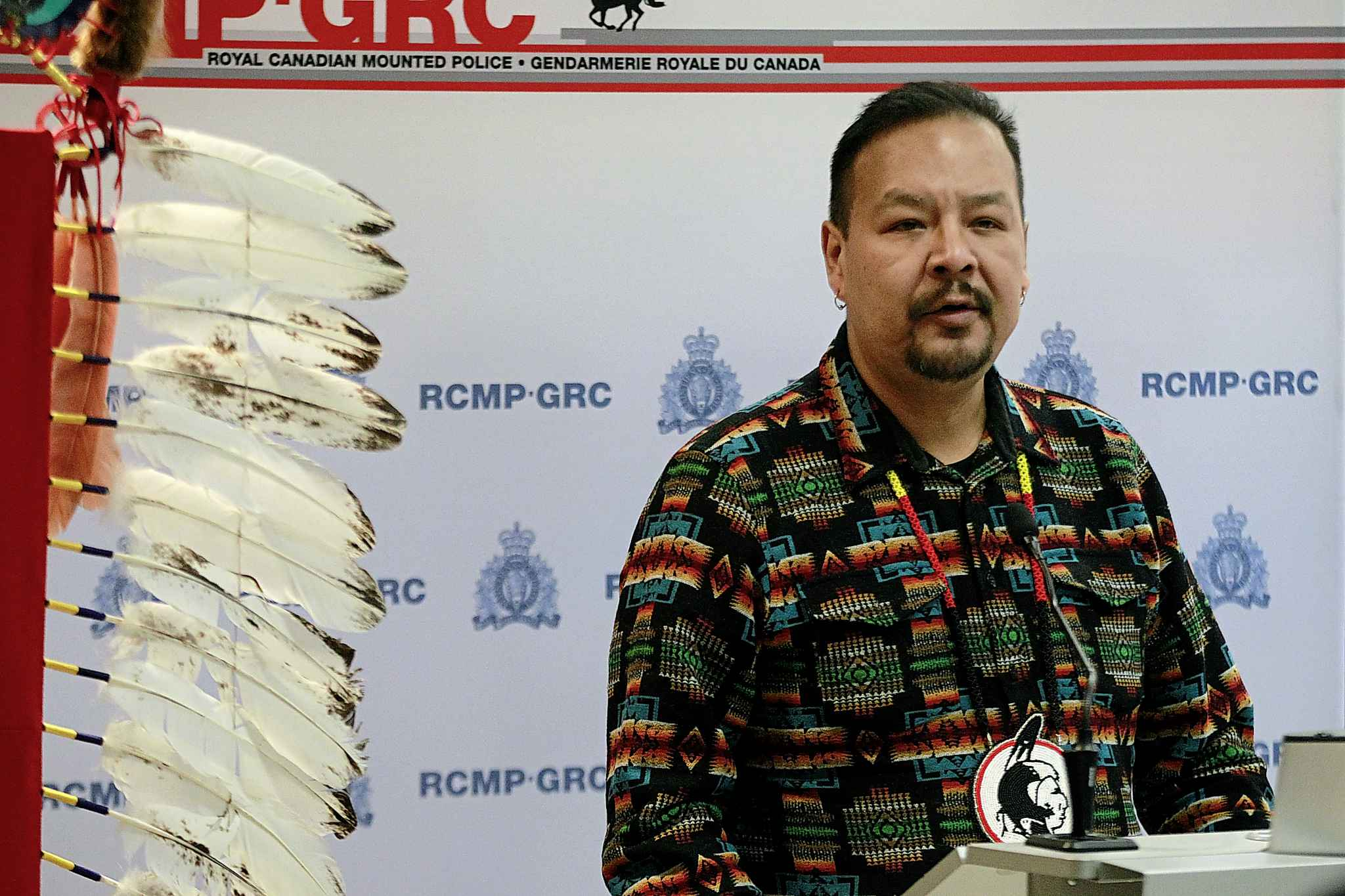 """Manitoba Regional Chief Kevin Hart addresses a press conference before eagle feathers at """"D"""" Division went through a ceremony, preparing them to be placed in detachments across Manitoba."""