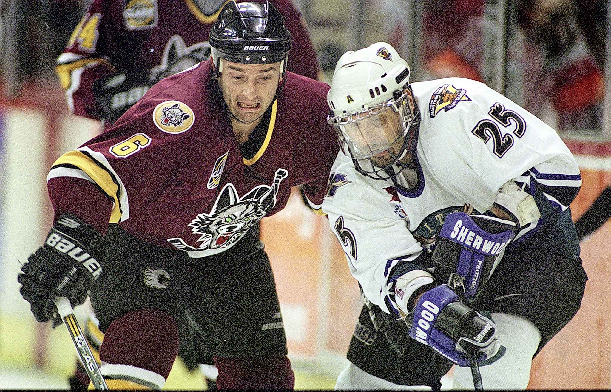 Eakins, left, as a member of the IHL's Chicago Wolves where he won a Turner Cup in 2001 playing for GM Kevin Cheveldayoff.