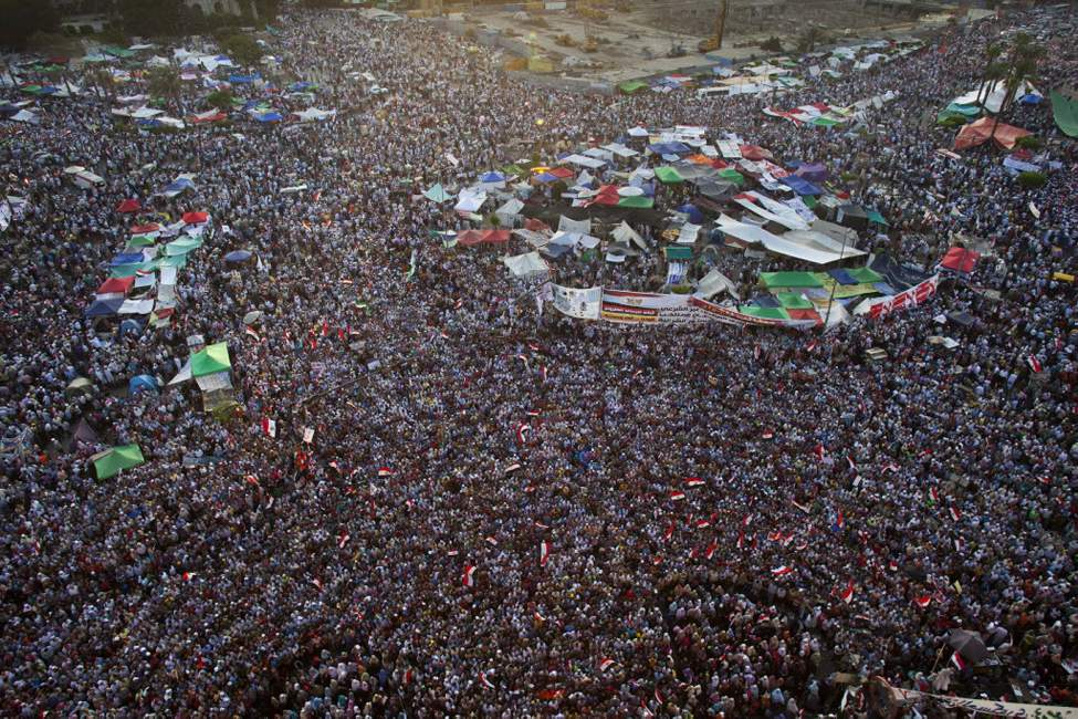 Egyptian supporters of the Muslim Brotherhood's candidate for president, Mohammed Morsi gather in Tahrir Square, Cairo, Egypt. Tens of thousands of Egyptians have converged on Tahrir Square in Cairo to protest against the ruling military council's power grab and in support of the Islamist presidential candidate who they believe won the election. (AP Photo/Bernat Armangue)