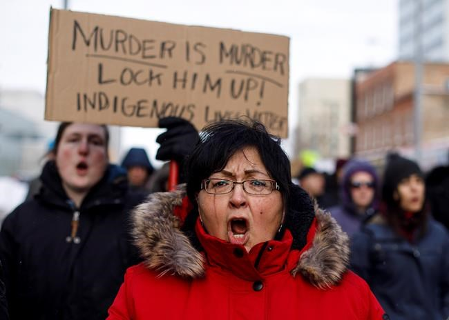 A marcher cries during a rally in response to Gerald Stanley's acquittal in the shooting death of Colten Boushie in Edmonton, Alta., on Saturday, February 10, 2018. THE CANADIAN PRESS/Jason Franson