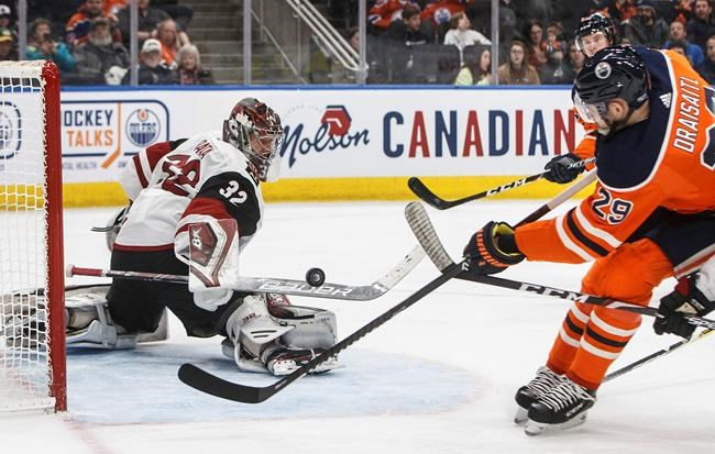 Arizona Coyotes goalie Antti Raanta (32) makes a save on Edmonton Oilers' Leon Draisaitl (29) during second period NHL action in Edmonton, Alta., on Saturday January 18, 2020. THE CANADIAN PRESS/Jason Franson