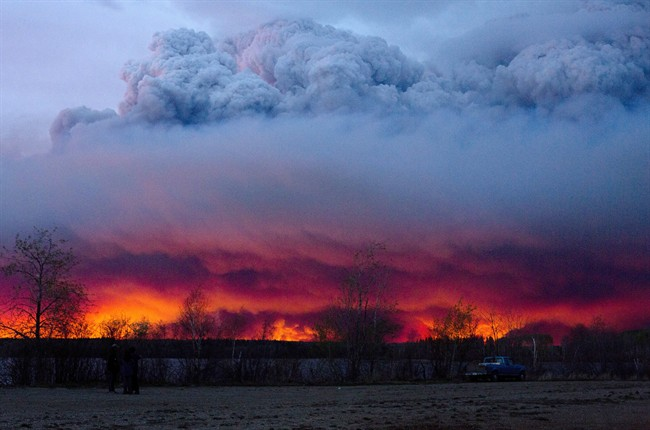 A wildfire moves towards the town of Anzac from Fort McMurray, Alta., on Wednesday May 4, 2016. The wildfire has already torched 1,600 structures in the evacuated oil hub of Fort McMurray and is poised to renew its attack in another day of scorching heat and strong winds.THE CANADIAN PRESS/Jason Franson