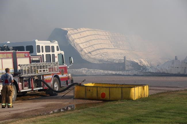 The aftermath of a dairy farm fire is shown northeast of Steinbach, Man. on Monday.