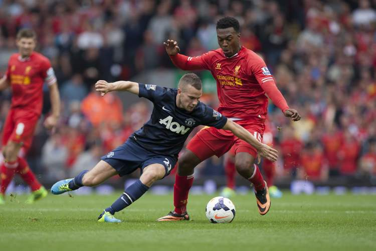 Liverpool's Daniel Sturridge (right) challenge's Manchester United's Tom Cleverley during English Premier League actionat Anfield Stadium, Liverpool, England, Sunday. Sturridge's goal led Liverpool to a 1-0 victory. (Jon Super / The Associated Press)