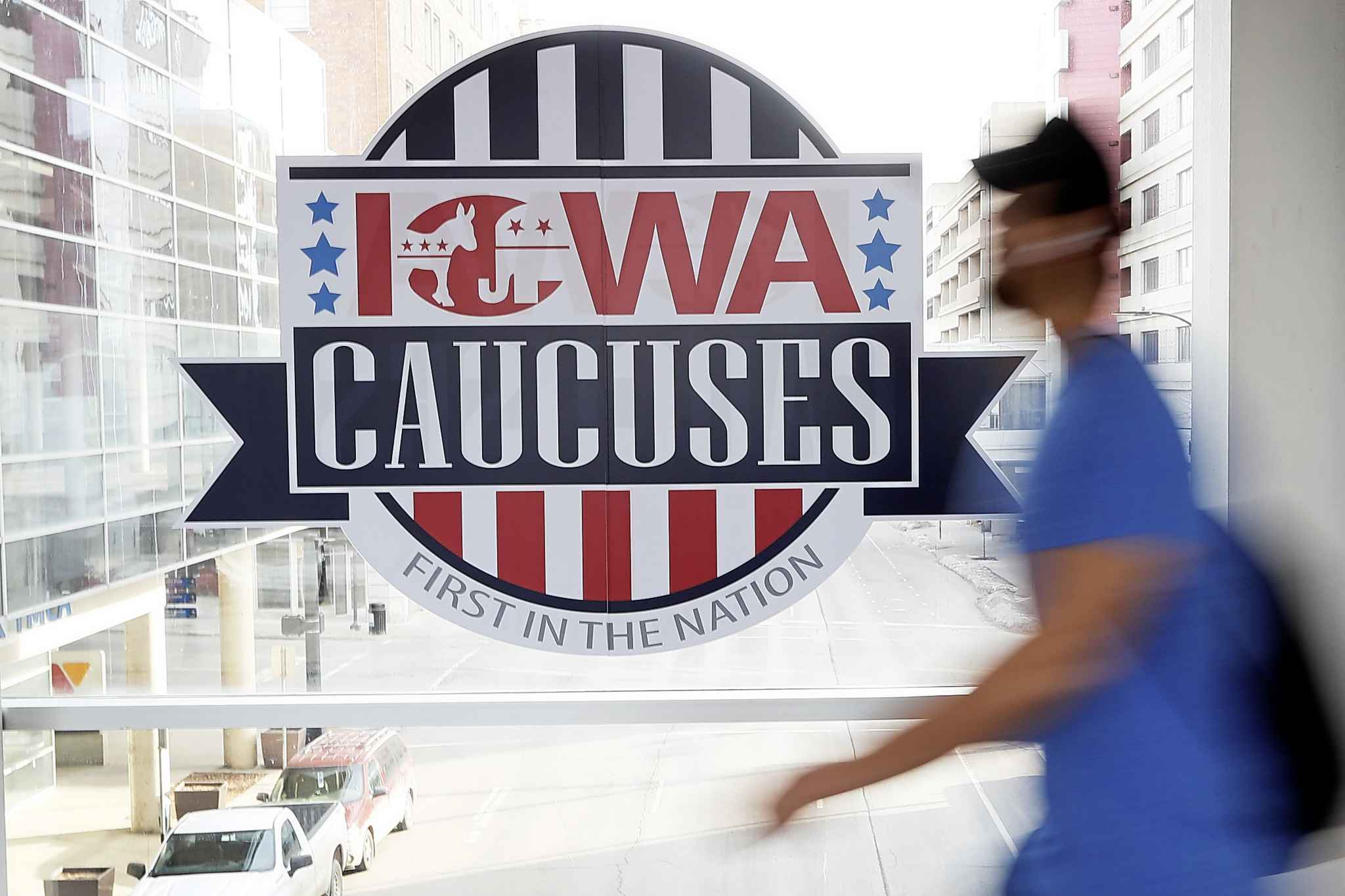 """The Democratic Party introduced new rules for this year's caucus that reallocates votes from candidates that are considered """"not viable"""" — those with less than 15 per cent support in any precinct — to """"viable"""" candidates, based on the voter's second choice. (Charlie Neibergall / The Associated Press)"""