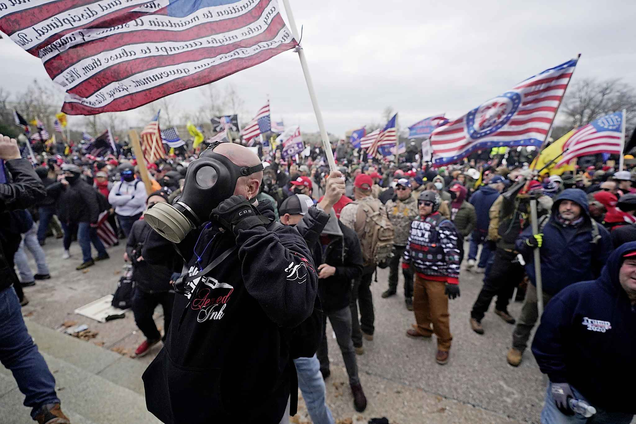 Trump supporters gather outside the Capitol, Wednesday, Jan. 6, 2021, in Washington. As Congress prepares to affirm President-elect Joe Biden's victory, thousands of people have gathered to show their support for President Donald Trump and his claims of election fraud. (AP Photo/Julio Cortez)