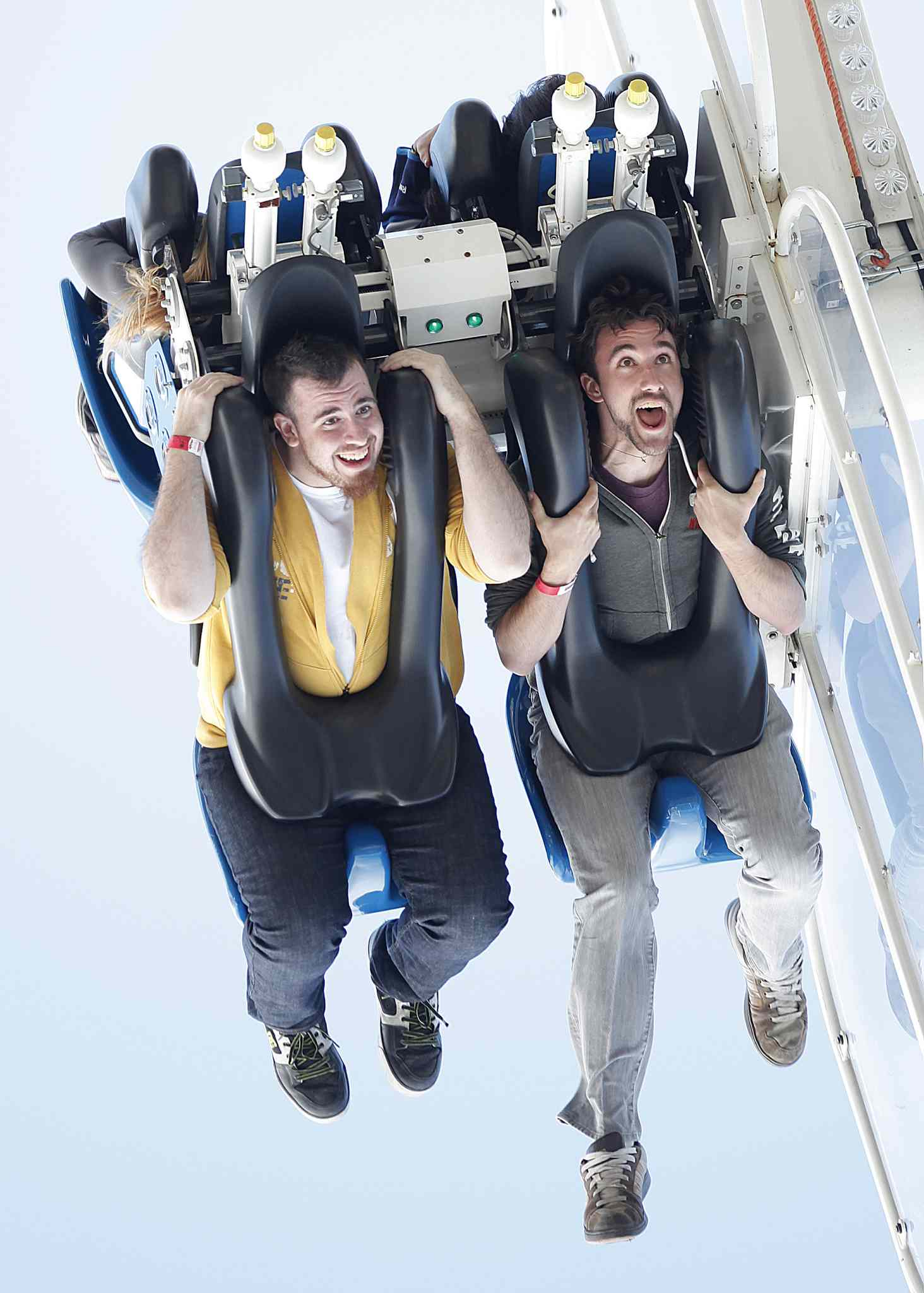 James Greenburgh, left, and Ian Moran on take a ride on Mach 3 at The Ex on Tuesday.