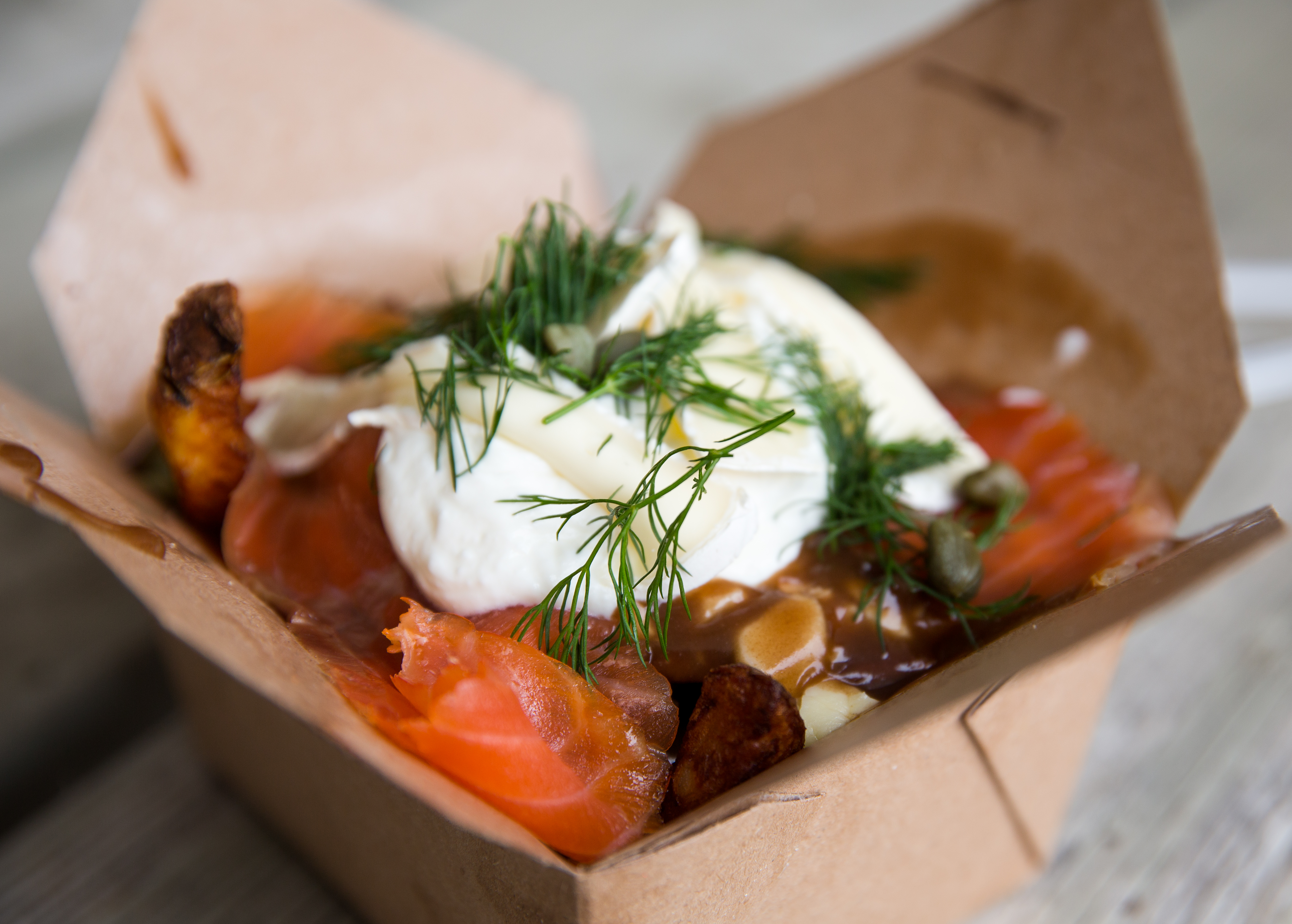 The Fisherman poutine at the Poutine King truck. Traditional poutine topped with smoked salmon, brie, sour cream, fresh dill and capers. Red River Ex food reviews - Jen Zoratti story 140613 - Friday, June 13, 2014 - (Melissa Tait / Winnipeg Free Press)