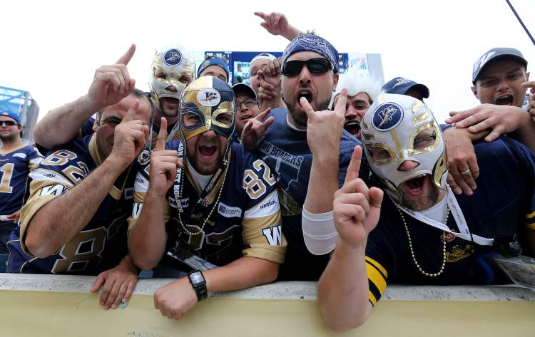 Winnipeg Blue Bombers' fans scream during the Banjo Bowl against the Saskatchewan Roughriders at Investors Group Field Sunday. The Bombers won beat the Sask. squad 25-13.