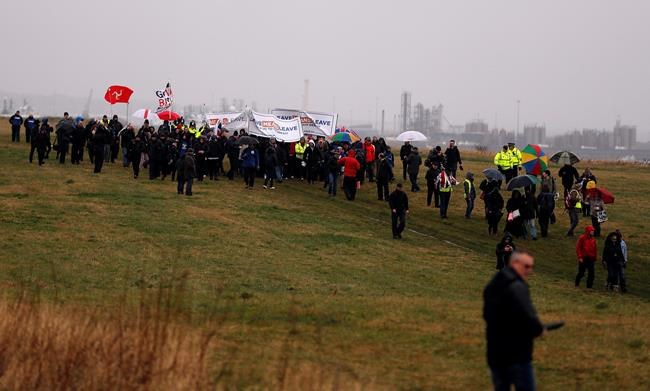 "Protestors walk along the coastline at the start of the first leg of March to Leave the European Union, in Sunderland, England, Saturday, March 16, 2019. Hard-core Brexiteers led by former U.K. Independence Party leader Nigel Farage set out on a two-week ""Leave Means Leave"" march between northern England and London, accusing politicians of ""betraying the will of the people."" (AP Photo/Frank Augstein)"