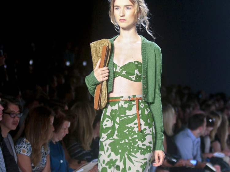 Fashion from the Michael Kors Spring 2014 collection is modelled on Wednesday, Sept. 11 in New York. (AP Photo / Bebeto Matthews)