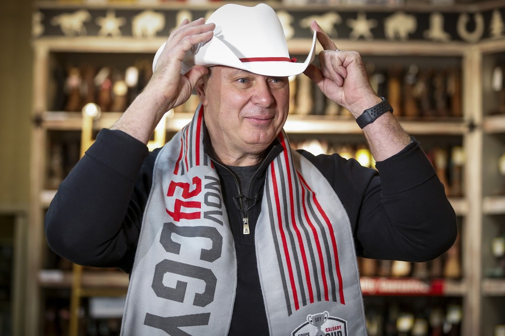 CFL commissioner Randy Ambrosie tries on a cowboy hat during Grey Cup week in Calgary last year. No one knows if there will even be a season this year. (Jeff McIntosh / The Canadian Press files)