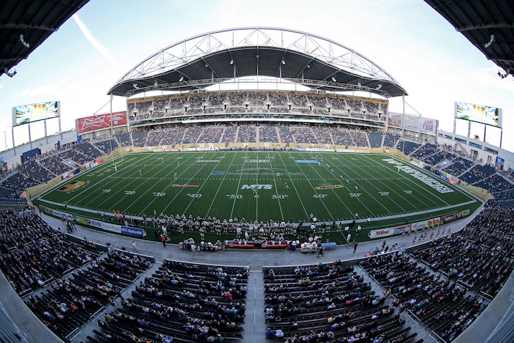 The Toronto Argonauts' kick the ball off to the Winnipeg Blue Bombers to open the game.