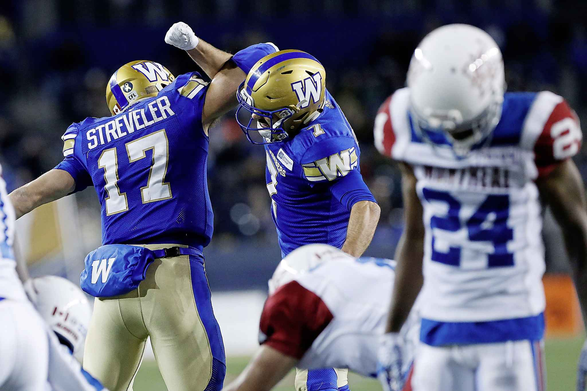 Chris Streveler and Weston Dressler celebrate Streveler's touchdown against the Montreal Alouettes Friday en route to a 31-14 victory. (John Woods / The Canadian Press)