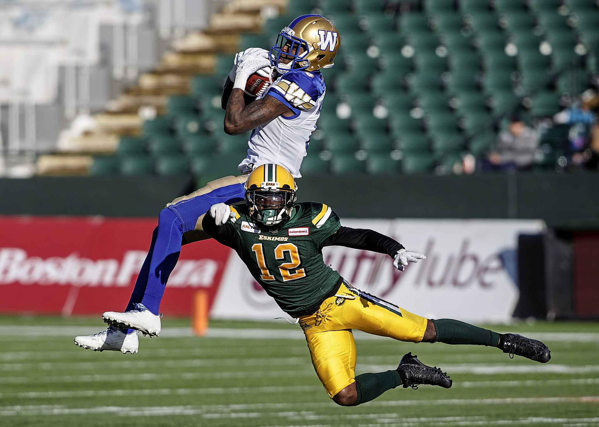 JASON FRANSON / THE CANADIAN PRESS</p><p>Winnipeg Blue Bombers Corey Washington (6) makes the catch as Edmonton Eskimos Forrest Hightower (12) tries to stop him during first half CFL action in Edmonton, Alta., on Saturday November 3, 2018.</p>