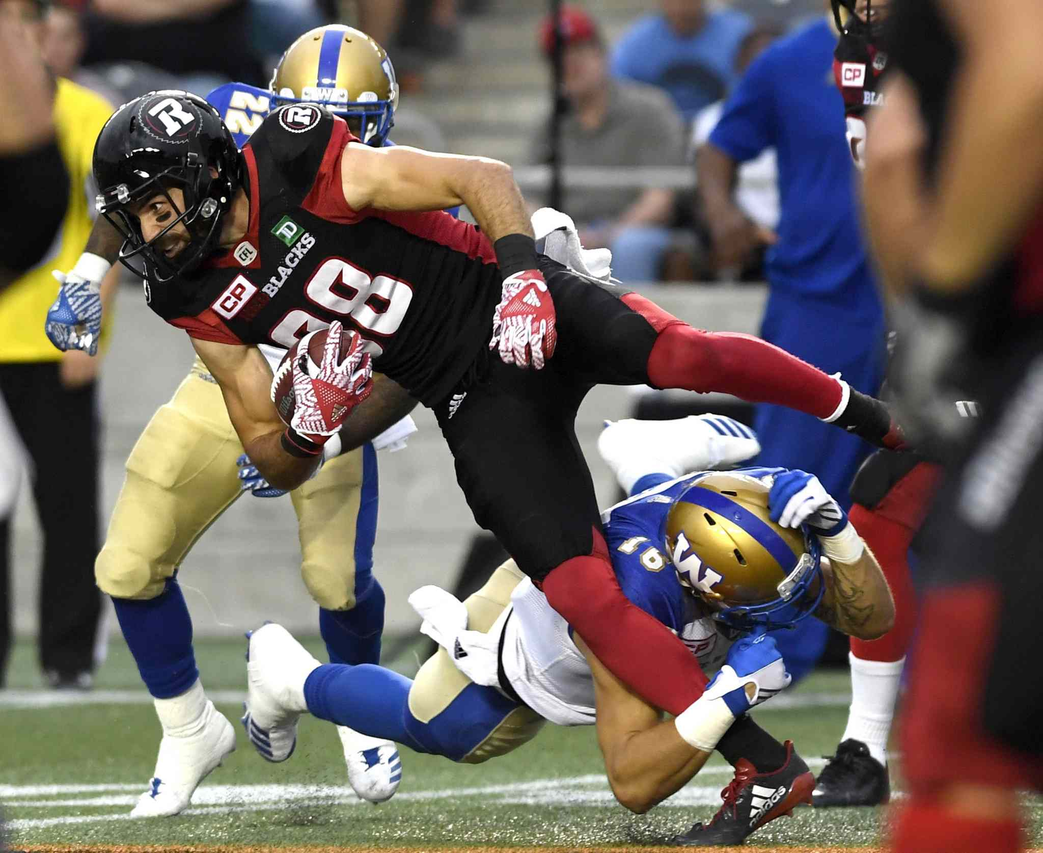 Ottawa's Brad Sinopoloi gets tackled by Taylor Loffler.